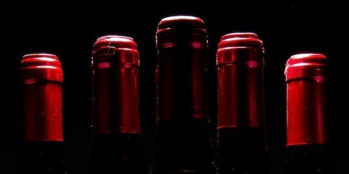 Red fine wine bottles top